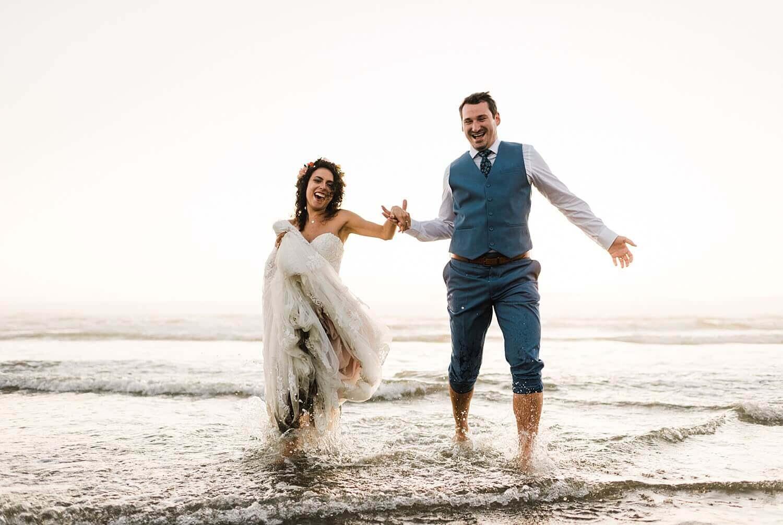 Arch Cape Oregon Coast elopement, running through water